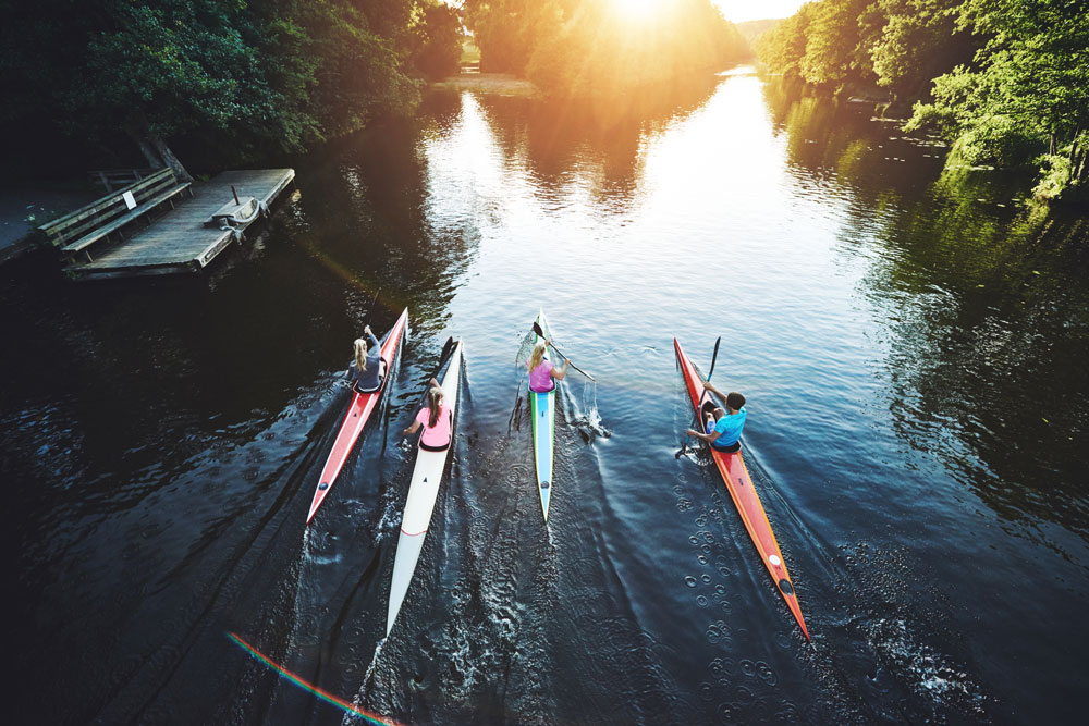 Aerial photo of four paddlers on a river.